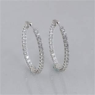 Pair of 14K white gold inside/out diamond hoop earrings