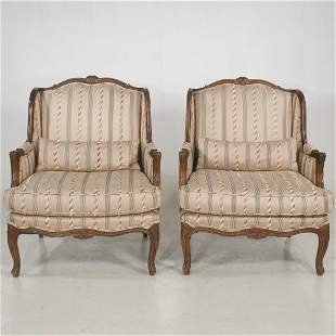 Pair of Louis XV style upholstered wing chairs