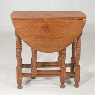 English oak gate leg drop leaf side table