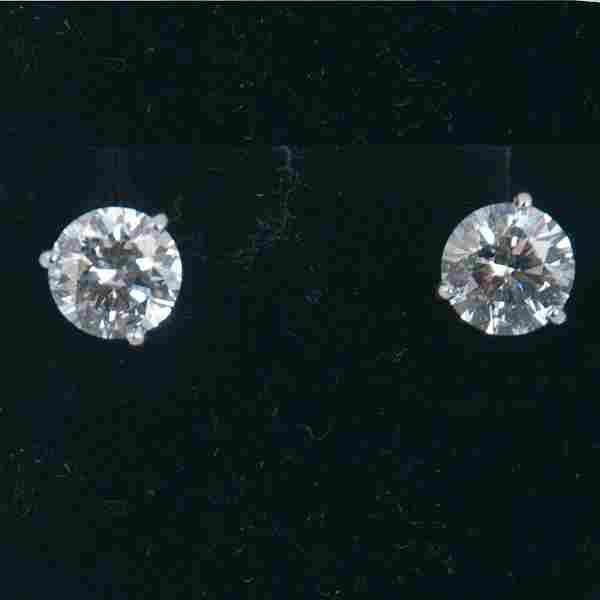 Pair of 14K white gold diamond stud earrings