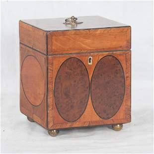 Sheraton mahogany tea caddy with oval inlay