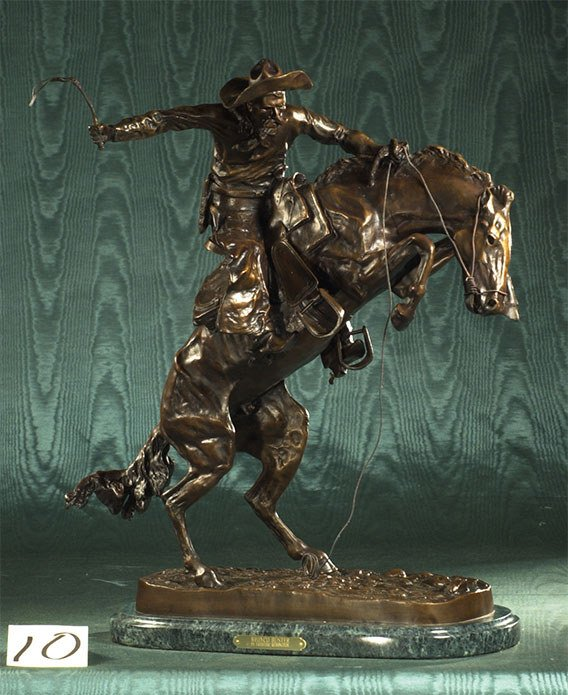 1010: Western bronze sculpture of a cowboy on horseback
