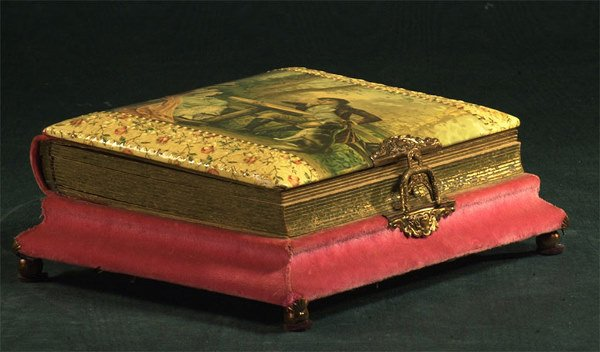 1024: Brass mounted Victorian album fitted with a music