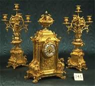 1141: Three-piece French Louis XVI doré clock set consi