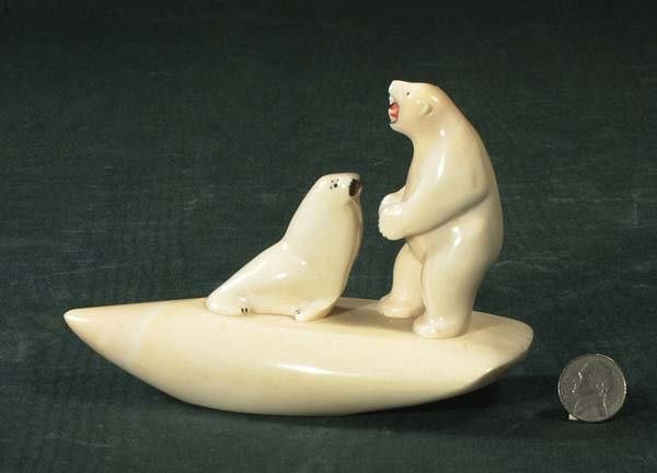 1008: Carved ivory figure of a polar bear and a seal