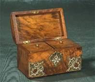 1023: English burl walnut tea caddy with brass mounts a