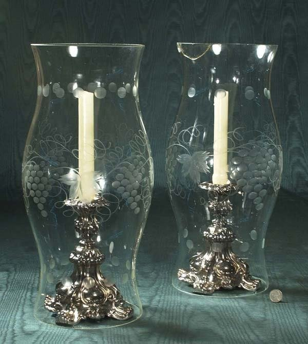 1453: Pair of silver plated candlesticks and a pair of