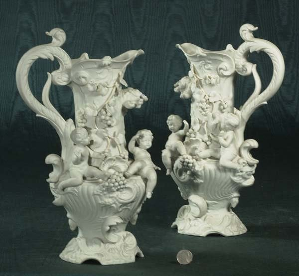 1455: Two white porcelain ewers with leaf, grape and ch