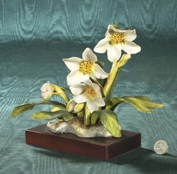 1467: Cybis porcelain flower on a wooden stand