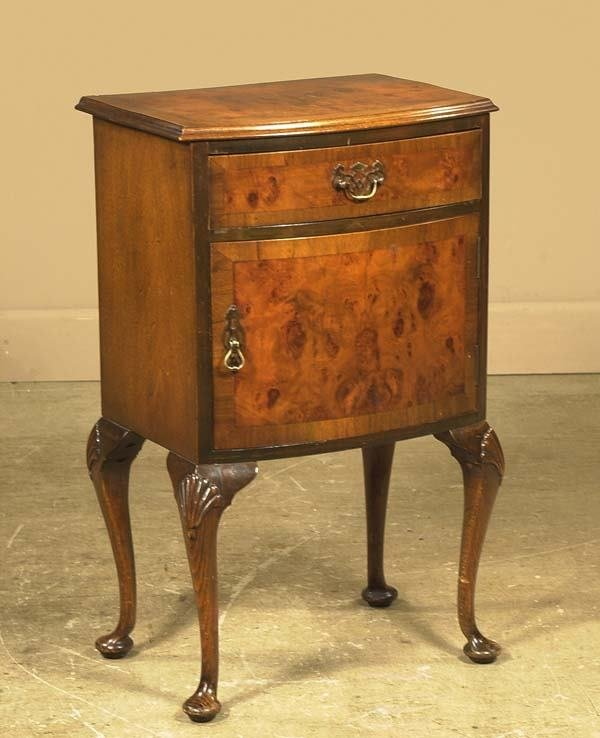 1470: Queen Anne burl walnut bow front stand on cabriol