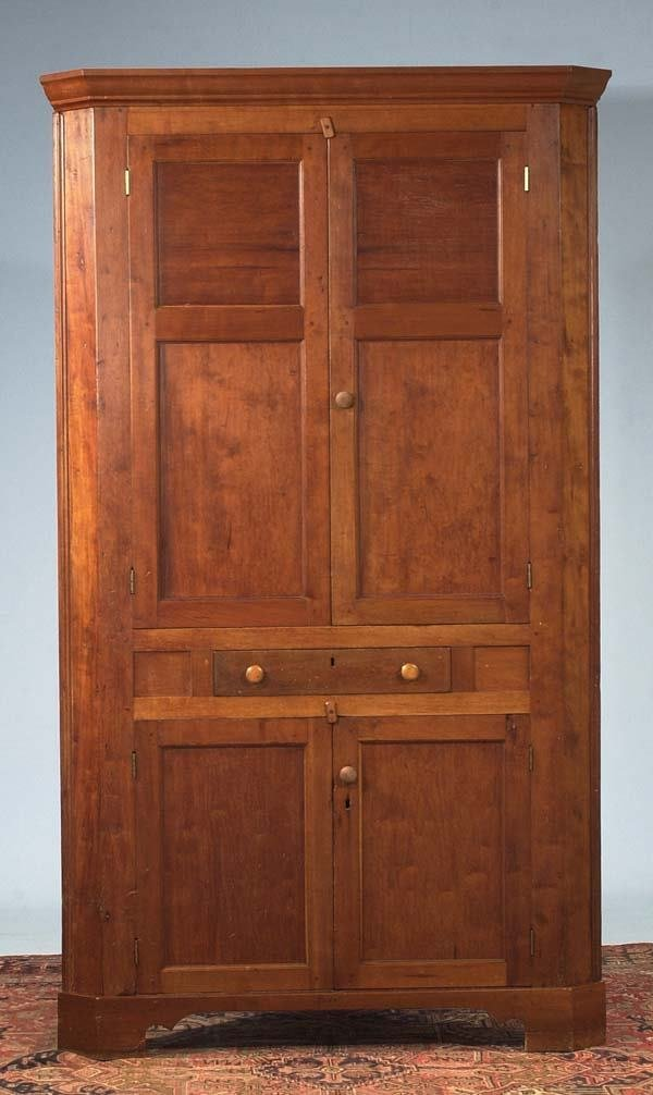 1595: American cherry corner cabinet with panel doors a