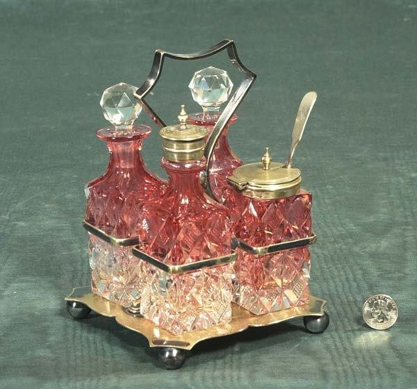 10: Cranberry to clear four bottle cruet set in a silve