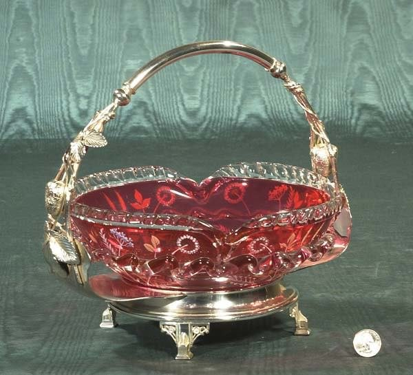 24: Cranberry glass bride's basket in a silver fame wit