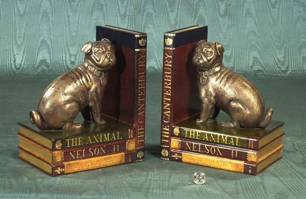 456: Pair of bookends having leather bound books surmou