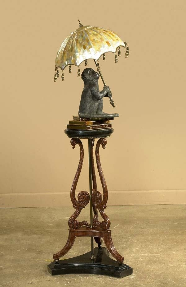 568: Unusual bronze monkey lamp with mother-of-pearl sh