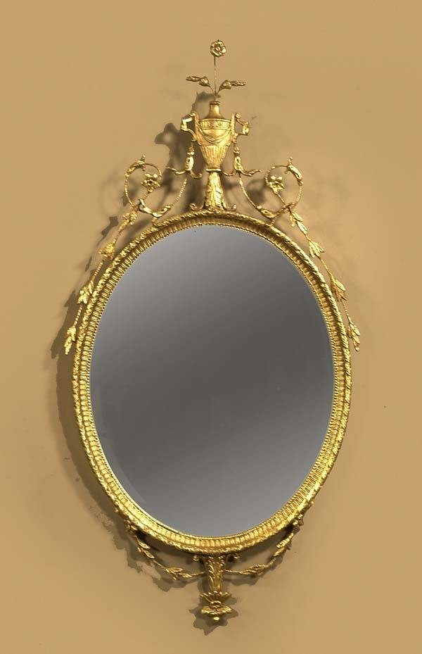 708: Superb oval Adams gilt mirror having urn and flora