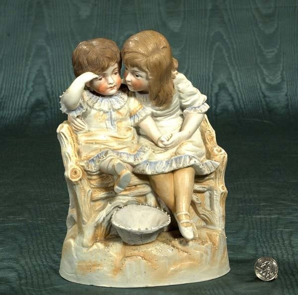 "1004: Bisque figure of a young boy and girl, 10"" high"