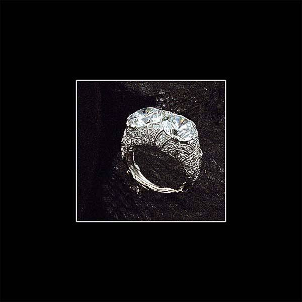 1005: Ladies white gold ring with two round cubic zirco