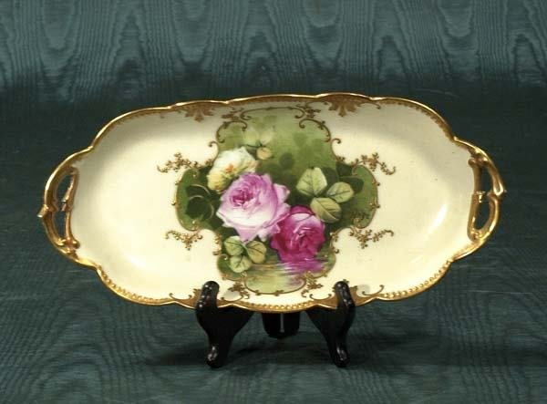 1018: Oval Limoges china tray with floral decoration, c