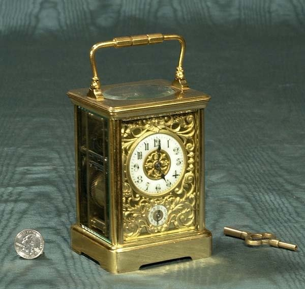 1165: Fine French brass carriage clock with enameled di