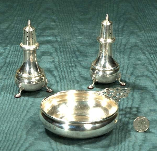 7: Sterling silver footed salt and pepper shakes and a