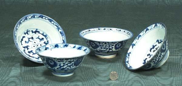 9: Set of four blue and white oriental porcelain bowls,