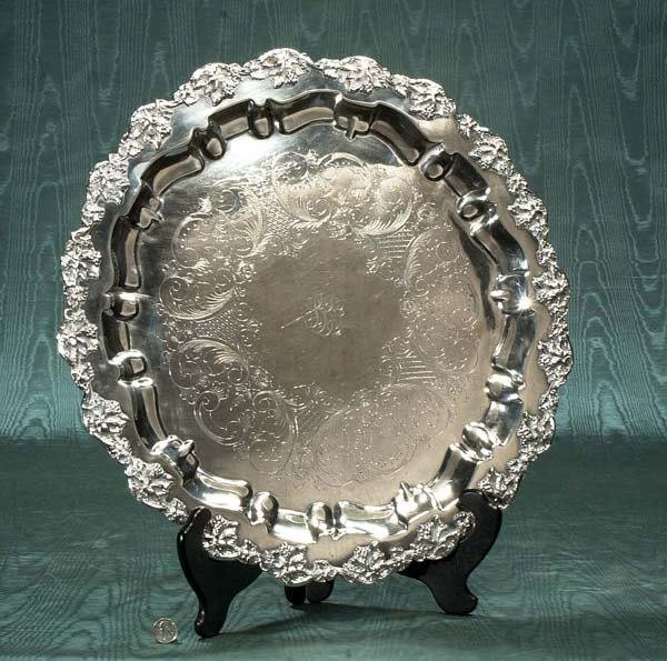 14: Round silver plated footed tray with hand chased le