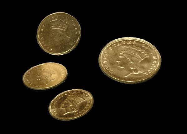20: Group of three U.S. one dollar gold coins and one U