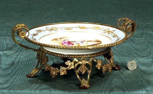 24: French porcelain centerpiece in a bronze stand with
