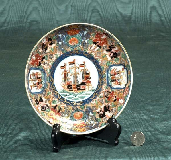 3: Black ship Imari plate with figural and floral decor
