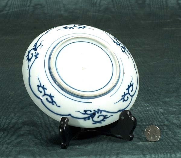 3: Black ship Imari plate with figural and floral decor - 2