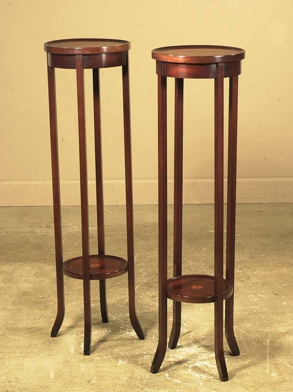 6: Pair of Sheraton style mahogany plant stands with sa