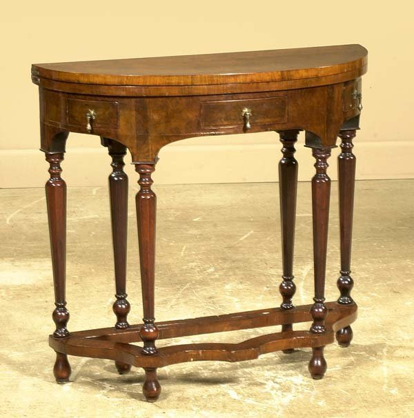 16: English walnut demilune lift top game and tea table