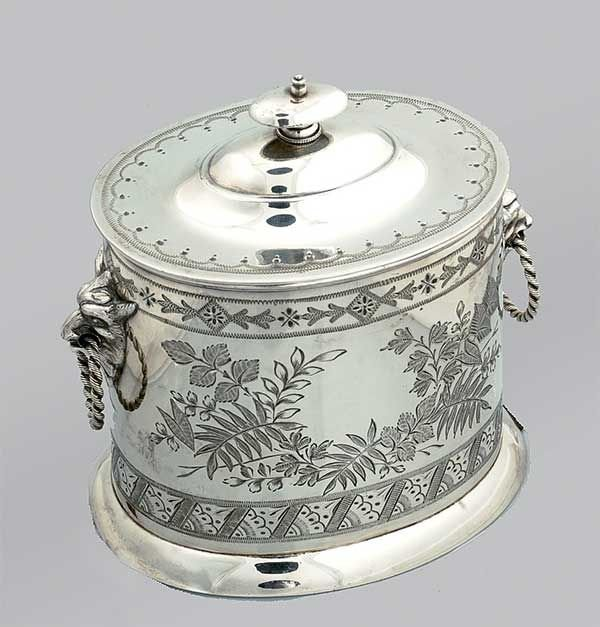 18: Oval English silver plated biscuit barrel with mask