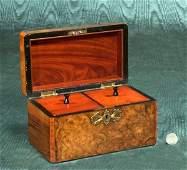 206: English burl walnut tea caddy with brass mounts an
