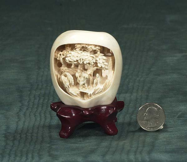 6: Chinese carved ivory apple form scene with people an