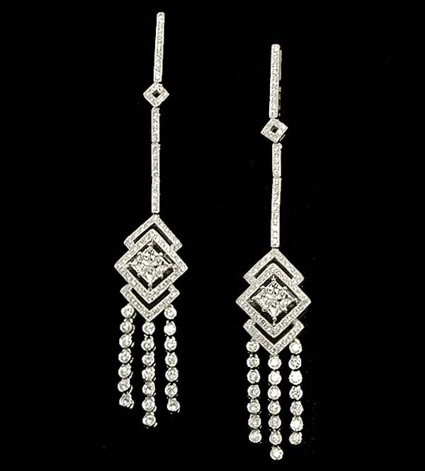 16: Pair of 18 kt. white gold dangle earrings, with 208