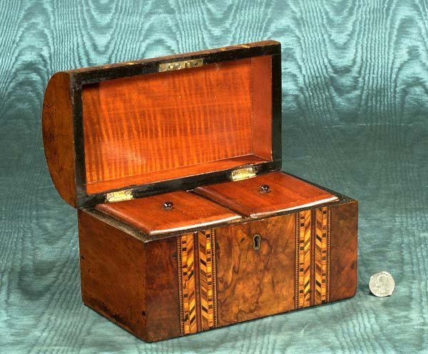 17: English dome top walnut tea caddy with parquetry in