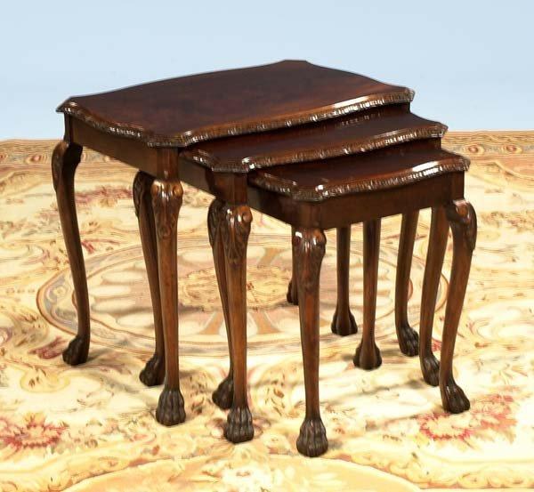 24: Nest of three English mahogany tables on hairy paw
