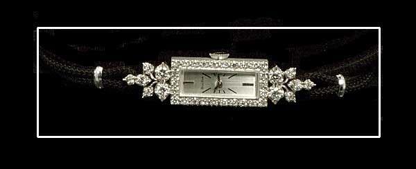 356: 14 kt. white gold Bulova wrist watch set with 38 d
