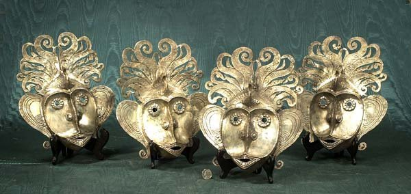 444: Collection of four silver masks from Bali