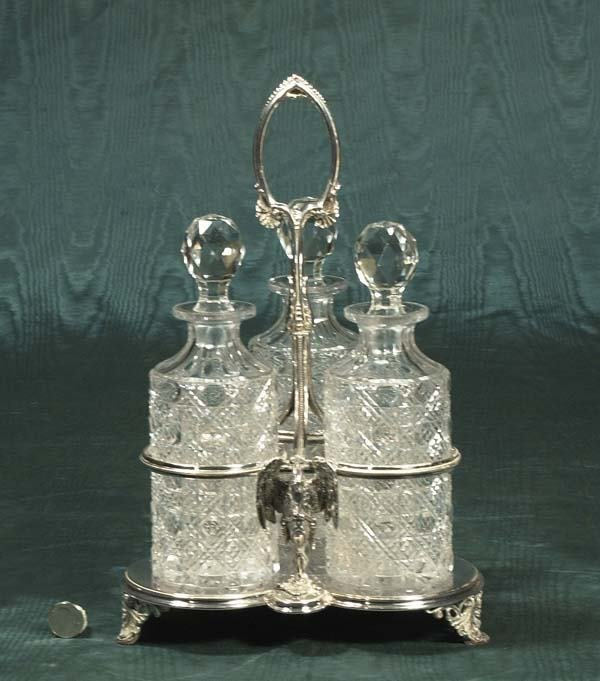 1009: English silver plated tantalus set with three cut
