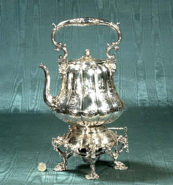 1015: English silver plated kettle on stand with scroll