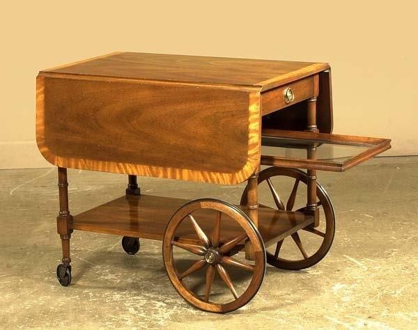 1020: Sheraton style mahogany drop leaf tea cart by Bak