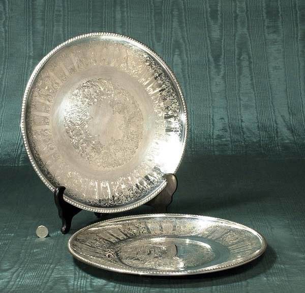 1023: Two sterling silver chargers with engraved decora