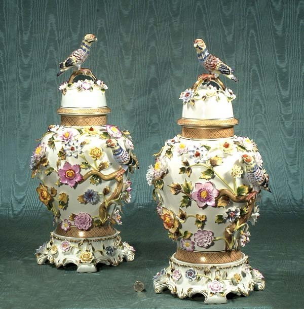 1257: Pair of dome top porcelain urns with bird and flo
