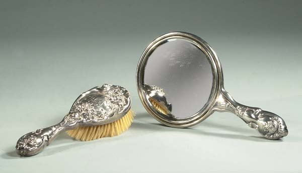 9: Sterling silver dressing mirror and a matching brush