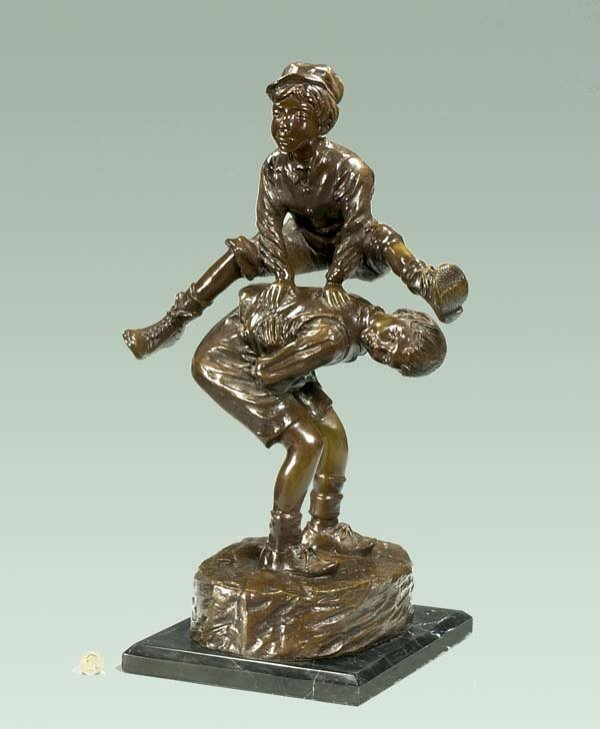 21: Bronze sculpture of two young boys playing leap fro