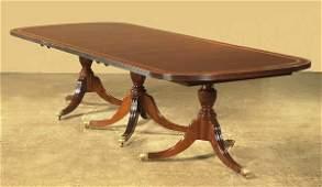 57: Fine three pedestal Sheraton style mahogany dining