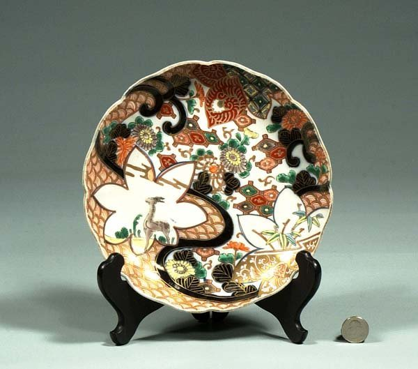 1006: Imari porcelain plate with floral and animal deco